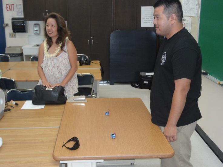 Senator Suzanne Chun-Oakland and Team Hawai'i Robotics Ryan Yamada