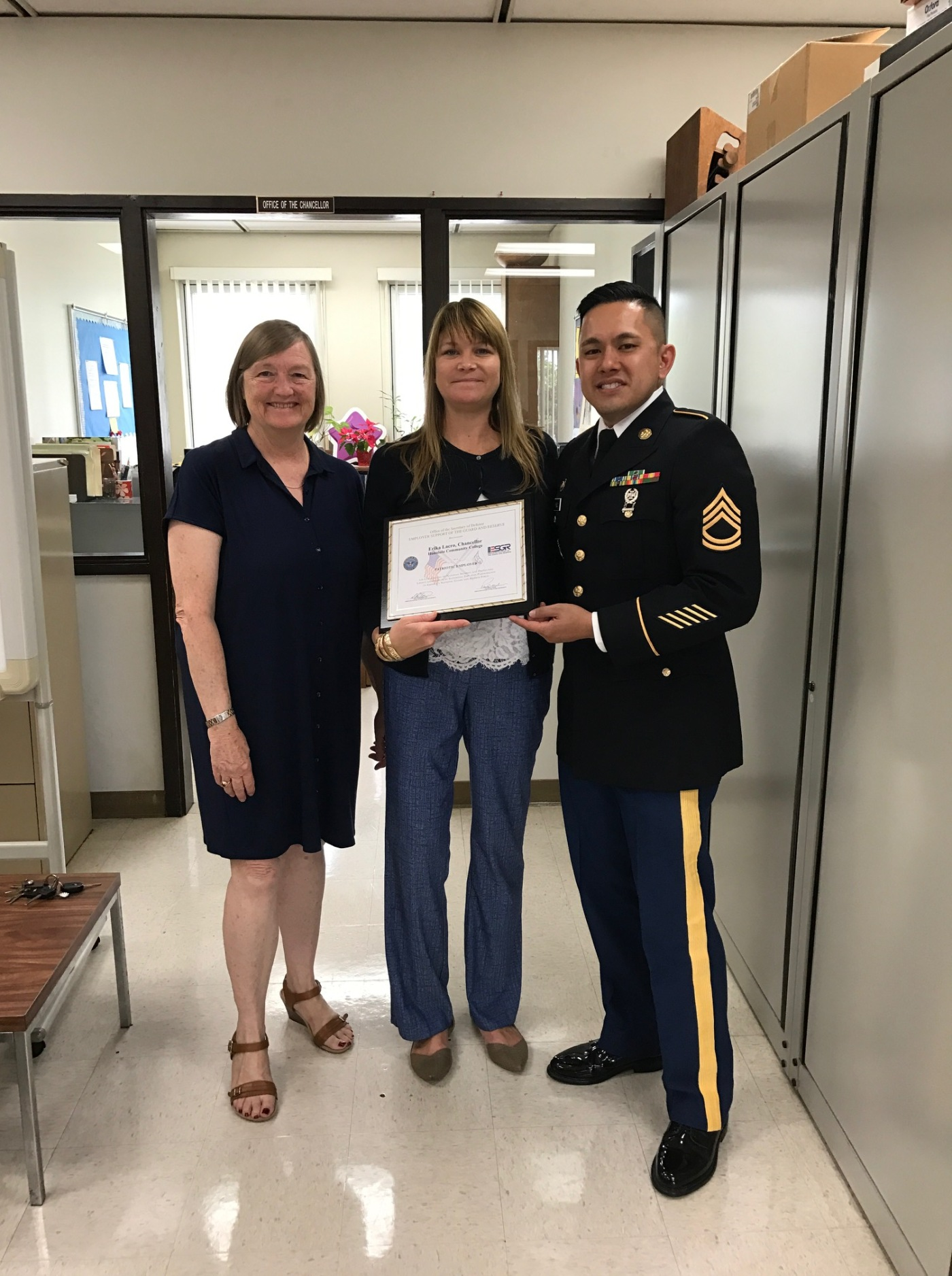 Pictured (L-R): Ann Geenlee with ESGR, Chancellor Lacro and Brent Rubio